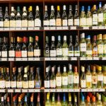 bottles of wine on shelves at liquor store