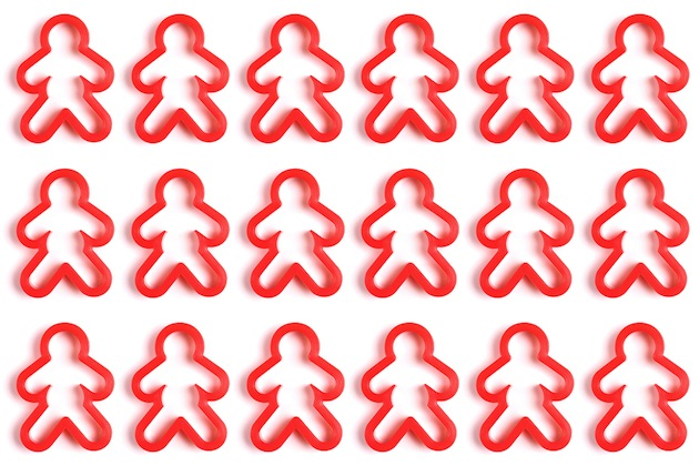 three rows of red gingerbread men cookie cutters