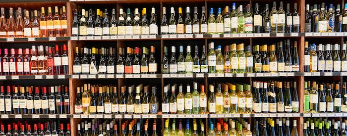 bottles of wine on shelves at liquor store
